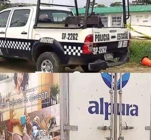La patrulla que  detuvo a un malhechor, y la camioneta donde se cometió el ilícito.
